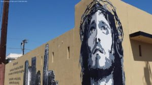 A wall mural of Jesus
