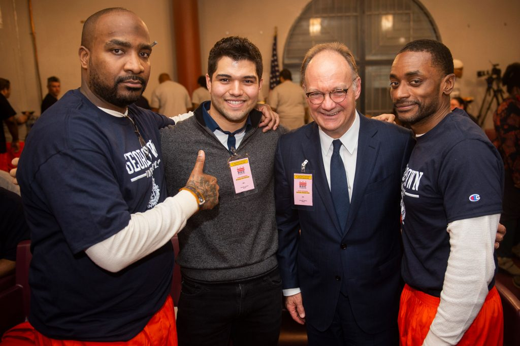Warren Allen with Georgetown student Matt Calderon, Georgetown University President John DeGioia, and classmate Roy Middleton.