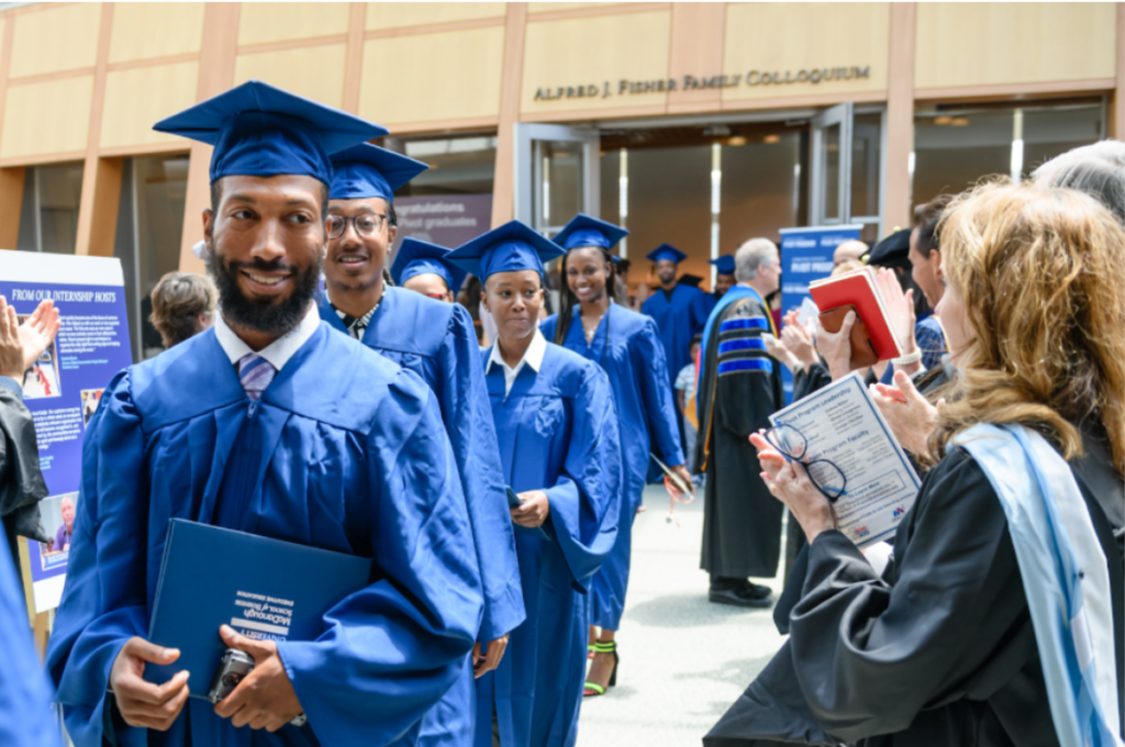 Pivot Program graduates in a processional