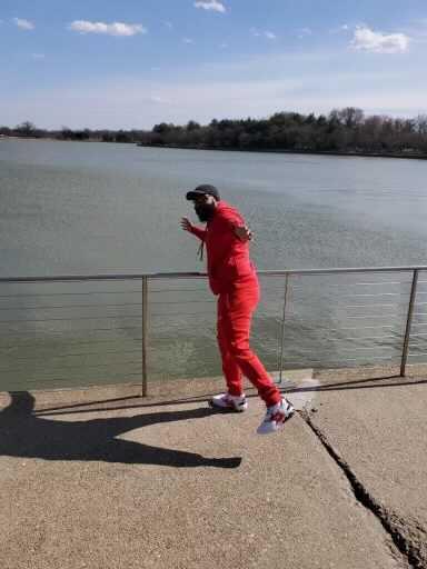 Warren Allen poses in front of the Potomac River.